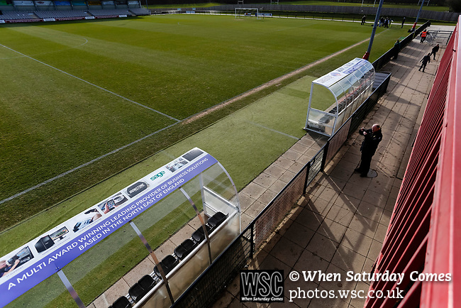 An early arrival photographing the ground on his phone. Darlington 1883 v Southport, National League North, 16th February 2019. The reborn Darlington 1883 share a ground with the town's Rugby Union club. <br /> After several years of relegations, bankruptcies, and ground moves, the club is fan owned, and back on an even keel in the National League North.<br /> A 0-0 draw with Southport was marred by a broken leg and dislocated knee suffered by Sam Muggleton, Darlington's on loan left back.<br /> Both teams finished the season in lower mid table.