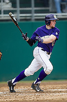 Washington Huskies third baseman Alex Schmidt (27) follows through on his swing during the NCAA baseball game against the Michigan Wolverines on February 16, 2014 at Bobcat Ballpark in San Marcos, Texas. The game went eight innings, before travel curfew ended the contest in a 7-7 tie. (Andrew Woolley/Four Seam Images)