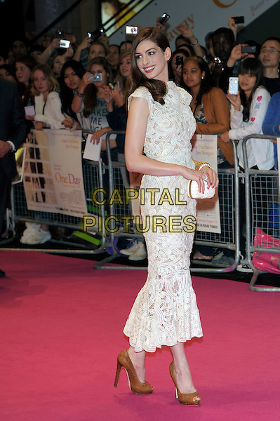 "Anne Hathaway (in Alexander McQueen).""One Day"" UK premiere, Vue Westfield cinema, Westfield Shopping Centre, London, England..August 23rd, 2011.full length white sleeveless crochet lace dress brown hazelnut whipstitch peep toe shoes white jaw skull clutch bag embroidered side looking over shoulder .CAP/PL.©Phil Loftus/Capital Pictures."