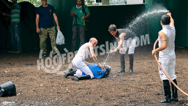 Corey Mongan getting the 1st win treatment by his fellow jockey's after winning aboard Fit For a Lady at Delaware Park on 6/4/16