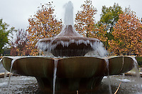 The water fountain at the entrance to Franciscan Estates with autumn leaves as background.