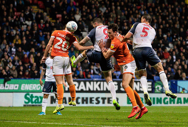 Bolton Wanderers' Daryl Murphy (centre) heads at goal<br /> <br /> Photographer Andrew Kearns/CameraSport<br /> <br /> The EFL Sky Bet League One - Bolton Wanderers v Blackpool - Monday 7th October 2019 - University of Bolton Stadium - Bolton<br /> <br /> World Copyright © 2019 CameraSport. All rights reserved. 43 Linden Ave. Countesthorpe. Leicester. England. LE8 5PG - Tel: +44 (0) 116 277 4147 - admin@camerasport.com - www.camerasport.com