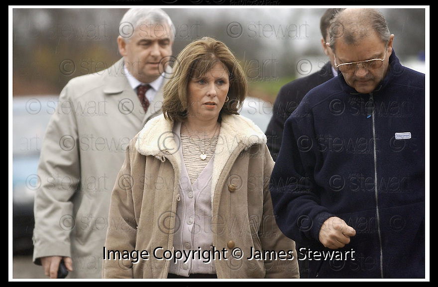 05/12/2001                 Copyright Pic : James Stewart .Ref : DSC_4014                          .File Name : stewart01-linn search.KATHLEEN LINN VISITS ONE OF THE SITES WHERE POLICE ARE SEARCHING FOR HER MISSING HUSBAND GARY LINN..... .SHE IS PICTURED BEING SHOWN AROUND THE SEARCH SITE BY INSPECTOR HENCHER ( RIGHT) OF CENTRAL SCOTLAND POLICE.....(see copy from Jim Davis).......James Stewart Photo Agency, Stewart House, Stewart Road, Falkirk. FK2 7AS      Vat Reg No. 607 6932 25.Office     : +44 (0)1324 630007     .Mobile  : + 44 (0)7721 416997.Fax         :  +44 (0)1324 630007.E-mail  :  jim@jspa.co.uk.If you require further information then contact Jim Stewart on any of the numbers above.........