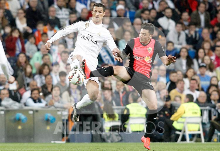 Real Madrid's Cristiano Ronaldo (l) and Almeria's Ximo Navarro during La Liga match. April 29,2015. (ALTERPHOTOS/Acero)
