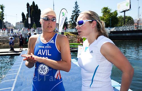 25 JUN 2011 - PONTEVEDRA, ESP - Hollie Avil (GBR) talks with British team physiotherapist Emma Deacon before the start of the Elite Women's European Triathlon Championships in Pontevedra, Spain (PHOTO (C) NIGEL FARROW)