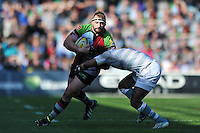 Joe Marler is tackled by Marland Yarde. Aviva Premiership match, between Harlequins and London Irish on March 29, 2014 at the Twickenham Stoop in London, England. Photo by: Patrick Khachfe / JMP