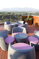 Grey wicker furniture on the terrace of five star hotel, Can Bonastre, allows a relaxing view towards Montserrat