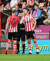 Lincoln City's Michael O'Connor, left, is replaced by Jason Shackell during the second half<br /> <br /> Photographer Chris Vaughan/CameraSport<br /> <br /> The EFL Sky Bet League Two - Lincoln City v Swindon Town - Saturday 11th August 2018 - Sincil Bank - Lincoln<br /> <br /> World Copyright &copy; 2018 CameraSport. All rights reserved. 43 Linden Ave. Countesthorpe. Leicester. England. LE8 5PG - Tel: +44 (0) 116 277 4147 - admin@camerasport.com - www.camerasport.com