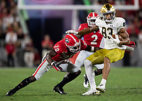 ATHENS, GA - SEPTEMBER 21: Chase Claypool #83 of the Notre Dame Fighting Irish is tackled by J.R. Reed #20 of the Georgia Bulldogs after a reception during a game between Notre Dame Fighting Irish and University of Georgia Bulldogs at Sanford Stadium on September 21, 2019 in Athens, Georgia.