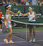 March 26 2016: Timea Bacsinszky (SUI), on right, shakes hands with Ana Ivanovic (SRB) after winning at the Miami Open being played at Crandon Park Tennis Center in Miami, Key Biscayne, Florida.