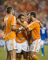 Houston Dynamo forward Nate Jaqua (21) and midfielder Brad Davis (11) celebrate Dwayne De Rosario's (14) 81st minute goal. The Houston Dynamo defeated the Kansas City Wizards 2-0 at Robertson Stadium in Houston, TX on November 10, 2007 to capture the MLS Western Conference Championship. The Houston Dynamo will take on the New England Revolution in the MLS Cup Final on November 18, 2007 at RFK Stadium in Washington D.C.