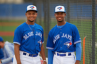 GCL Blue Jays Jose Brito (32) and Juanfer Castro (44) before a Gulf Coast League game against the GCL Tigers West on August 3, 2019 at the Englebert Complex in Dunedin, Florida.  GCL Blue Jays defeated the GCL Tigers West 4-3.  (Mike Janes/Four Seam Images)
