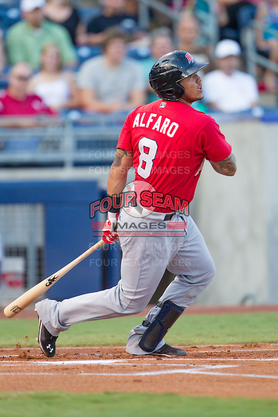 Frisco RoughRiders catcher Jorge Alfaro (8) watches the ball as he heads toward first base during the Texas League game against the Tulsa Drillers at ONEOK field on August 15, 2014 in Tulsa, Oklahoma  The RoughRiders defeated the Drillers 8-2.  (William Purnell/Four Seam Images)