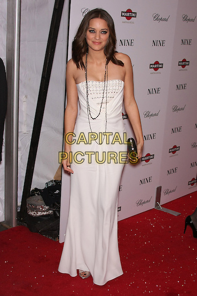 "MARION COTILLARD.New York Premiere of ""NINE"" held at the Ziegfeld Theater, New York, NY, USA..December 15th, 2009.full length white strapless dress silver clutch bag beads necklace .CAP/LNC/TOM.©TOM/LNC/Capital Pictures."