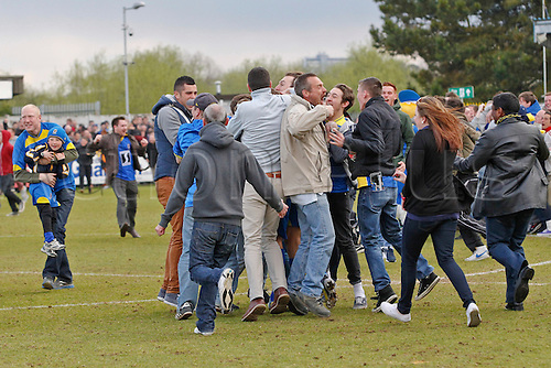 27.04.2013 Kingston upon Thames, England.  Pitch invasion as AFC Wimbledon celebrate victory and avoid relegation from the Football League during the League Two game between AFC Wimbledon and Fleetwood Town