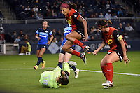 Kansas City, Kansas - Saturday April 16, 2016: FC Kansas City goalkeeper Nicole Barnhart (18) makes a save in front of Western New York Flash defender Abby Erceg (6) and defender Jessica McDonald (14) in the first half at Children's Mercy Park.