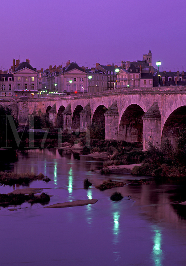 Loire Valley, France, Orleans, Loire Castle Region, Loiret, Centre, Europe, Reflection of the town of Orleans and the stone bridge in the Loire River in the evening.