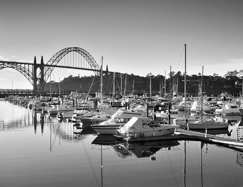 Boats in Yaquina Bay with bridge. Newport, Oregon