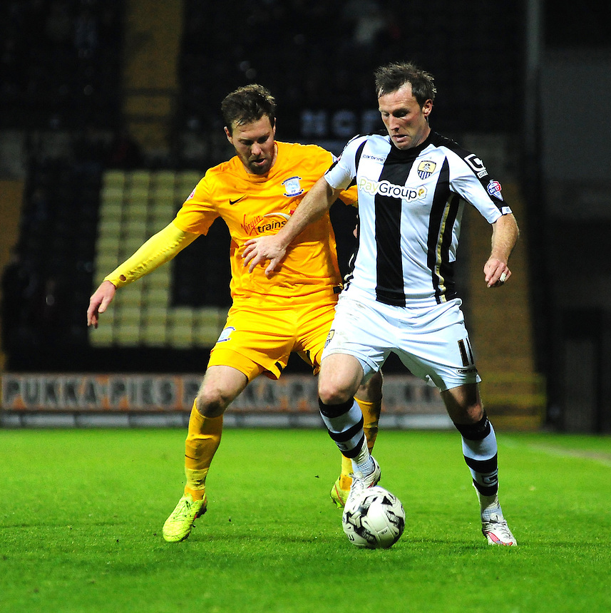 Notts County's Garry Thompson shields the ball from Preston North End's Scott Laird <br /> <br /> Photographer Chris Vaughan/CameraSport<br /> <br /> Football - The Football League Sky Bet League One - Notts County v Preston North End - Tuesday 21st April 2015 - Meadow Lane - Nottingham<br /> <br /> &copy; CameraSport - 43 Linden Ave. Countesthorpe. Leicester. England. LE8 5PG - Tel: +44 (0) 116 277 4147 - admin@camerasport.com - www.camerasport.com