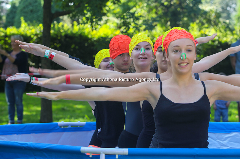 2016 09 18<br /> Pictured: Performers with synchronised swimming display in empty paddling pools, The Great Pyjama Picnic, Bute Park, Cardiff.Sunday 18 September 2016<br /> Re: Roald Dahl&rsquo;s City of the Unexpected has transformed Cardiff City Centre into a landmark celebration of Wales&rsquo; foremost storyteller, Roald Dahl, in the year which celebrates his centenary.