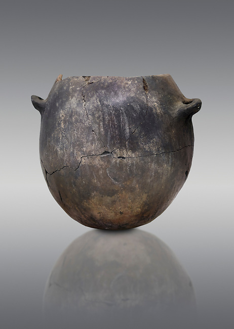 Neolithic terracotta pot . Catalhoyuk collection, Konya Archaeological Museum, Turkey. Against a gray background