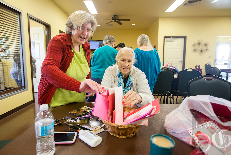 NWA Democrat-Gazette/JASON IVESTER<br /> Verna Foresee (left) and Evelyn Edwards, both of Lowell, work on Valentine's Day cards Thursday, Feb. 9, 2017, at the Lowell Senior Activity Center. Members created the cards to be distributed to area nursing home residents and through the Meals on Wheels program.