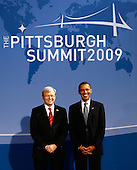 Pittsburgh, PA - September 24, 2009 -- United States President Barack Obama (R) welcomes Australian Prime Minister Kevin Rudd to the welcoming dinner for G-20 leaders at the Phipps Conservatory on Thursday, September 24, 2009 in Pittsburgh, Pennsylvania. Heads of state from the world's leading economic powers arrived today for the two-day G-20 summit held at the David L. Lawrence Convention Center aimed at promoting economic growth..Credit: Win McNamee / Pool via CNP