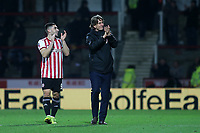 Neal Maupay, scorer of Brentford's only goal and Brentford Manager, Thomas Frank applaud the fans at the end of the match during Brentford vs Oxford United, Emirates FA Cup Football at Griffin Park on 5th January 2019