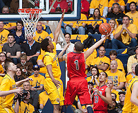 Tyrone Wallace of California tries to block the ball against Gabe York of Arizona during the game at Haas Pavilion in Berkeley, California on February 1st, 2014.  California Golden Bears defeated Arizona Wildcats, 60-58.