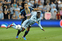 Peterson Joseph (19) Sporting KC midfielder takes a tumble by Union midfielder Danny Cruz..Sporting Kansas City defeated Philadelphia Union 2-1 at LIVESTRONG Sporting Park, Kansas City, KS.