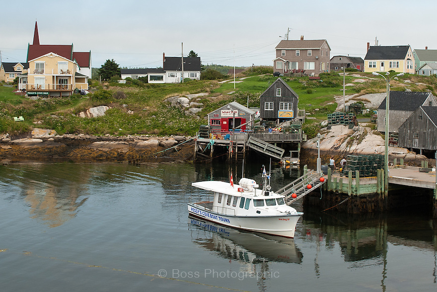 Tour boat tied up at dock, Peggy's Cove, Nova Scotia
