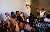 Havana capitol city of Cuba with Baptist church in building with woman preaching sermon to crowd