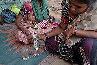 Rani Barukaum, the local SHG leader conducts tests to check the quality of water in Ambedkar Nagar in Medak, Telangana, India.