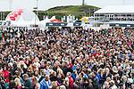 Jozias Johannes van Aartsen, mayor of The Hague and Knut Frostad, Volvo Ocean Race CEO ,eat an Herring at the Scheveningen Harbour. Volvo Ocean Race teams will make a 24-hours pit stop of the Volvo Ocean Race Leg 9 Lorient - Gothenburg on June 18, 2015 in The Hague, Netherlands. Photo by Victor Fraile / Power Sport Images