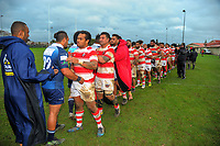Players shake hands after the Auckland Premier club rugby match between Papatoetoe and College Rifles at Papatoetoe Rugby Club in Auckland, New Zealand on Friday, 28 April 2018. Photo: Dave Lintott / lintottphoto.co.nz