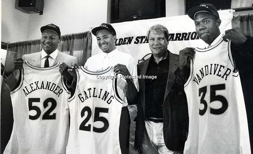 Golden State Warriors 1991 new rookies, Victor Alexander, Chris Gatling and Shaun Vandiver with coach Don Nelson. (1991 photo)