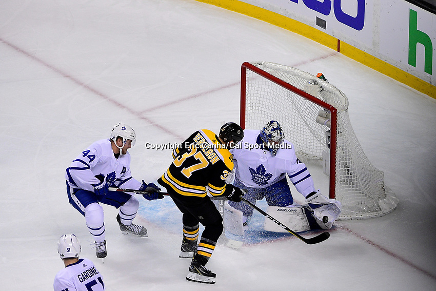 April 21, 2018: Toronto Maple Leafs goaltender Frederik Andersen (31) stops a shot by Boston Bruins center Patrice Bergeron (37) during game five of the first round of the National Hockey League's Eastern Conference Stanley Cup playoffs between the Toronto Maple Leafs and the Boston Bruins held at TD Garden, in Boston, Mass. Toronto defeats Boston 4-3, Boston leads Toronto 3 games to 2 in the best of 7 series.