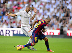 "Karim Benzema and Dani Alves during the Spanish league ""Clasico"" football match Real Madrid CF vs FC Barcelona at the Santiago Bernabeu stadium in Madrid on October 25, 2014.  PHOTOCALL3000 / DP"