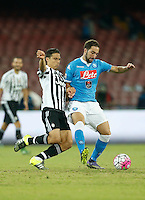 Juventus' Hernanes challengesNapoli's Gonzalo Higuain  during their  italian serie a soccer match,    at  the San  Paolo   stadium in Naples  Italy , September 26 , 2015