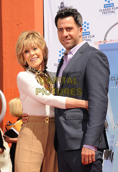 Jane Fonda, Troy Garity.Jane Fonda's Hand and Footprint Ceremony during the 2013 TCM Classic Film Festival at TCL Chinese Theatre in Hollywood, California, USA..April 27th, 2013.half length white top leopard print scarf beige trousers pink shirt suit grey gray mother mom mum son family arms around waist hug embrace .CAP/ROT/TM.©Tony Michaels/Roth Stock/Capital Pictures