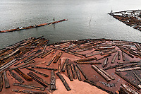 Colombian wood cutters float timbers from the Pacific rainforest in a sea bay close to Tumaco, Colombia, 15 June 2010. Tens of sawmills located on the banks of the Pacific jungle rivers generate almost half of the Colombia's wood production. The wood species processed here (sajo, machare, roble, guabo, cargadero y pacora) are mostly used in the construction industry and the paper production. Although the Pacific lush rainforest in Colombia is one of the most biodiverse area of the world, the region suffers an extensive deforestation due to the uncontrolled logging in the last years.