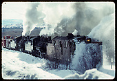 A 3/4 view of a rotary snowplow train with rotary #OY, 2 locomotives, a work box car, and long caboose #05635.<br /> C&amp;TS  Chama, NM  prior to 2/1978
