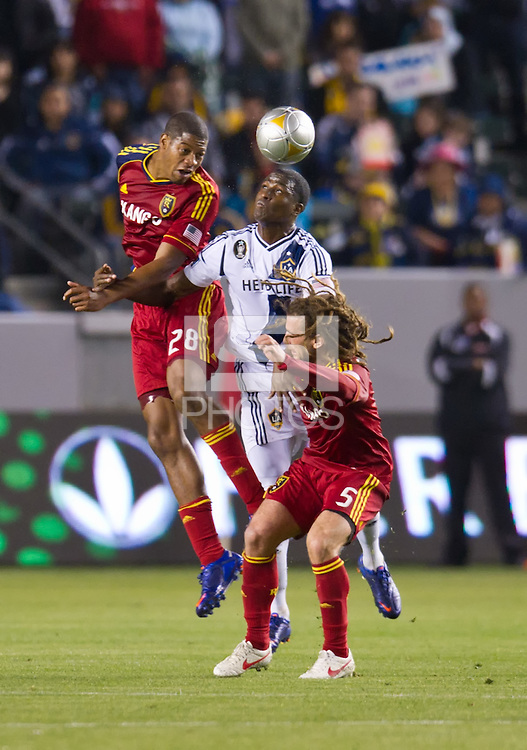 CARSON, CA - March 10,2012: Real Salt Lake defender Chris Schuler (28) and midfielder Kyle Beckerman (5) and LA Galaxy forward Edson Buddle (14) during the LA Galaxy vs Real Salt Lake match at the Home Depot Center in Carson, California. Final score LA Galaxy 1, Real Salt Lake 3.