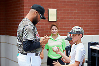 Arkansas Travelers pitcher Peter Tago (36) signs autographs for fans during a game against the Frisco RoughRiders on May 28, 2017 at Dickey-Stephens Park in Little Rock, Arkansas.  Arkansas defeated Frisco 17-3.  (Mike Janes/Four Seam Images)