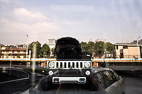 A Hummer sport utility vehicle is seen through a window reflecting blue skies in Nanjing, Jiangsu, China.  In June 2009, General Motors announced it had sold the Hummer brand to Chengdu, China-based Sichuan Tengzhong Heavy Industrial Machinery Company.