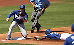 Texas Rangers' Delino DeShields dives safely under the tag of Los Angeles Dodgers' Justin Turner during a spring training game in Surprise, Ariz., on Saturday, March 26, 2017.<br /> Photo by Cathleen Allison/Nevada Photo Source