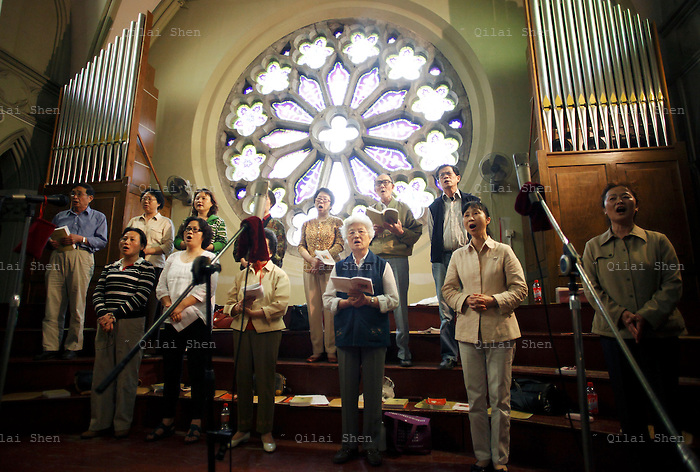 Choir members sing during a wedding ceremonies at the Xujiahui Catholic Church in Shanghai, China on 23 May 2009. A hip street artist and a recent Catholic convert, Mr. Dai is one of many young Chinese embracing religion, perhaps to fill the lack of belief and ideology in an authoritarian communist China that embraces the most extreme form of capitalism in practice. The Chinese government and the Vatican have a long history of simmering mutual distrust and suspicion, as two parties compete for the control of the Chinese Catholic church, with some 15 million and growing number of faithfuls.  Overall Christians now number over 110 million in China, which makes it the third largest Christian nation in the world.