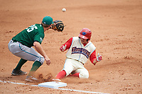 Clearwater Threshers Scott Kingery (31) slides in as third baseman Taylor Sparks (25) fields the throw during a game against the Daytona Tortugas on April 20, 2016 at Bright House Field in Clearwater, Florida.  Clearwater defeated Daytona 4-2.  (Mike Janes/Four Seam Images)