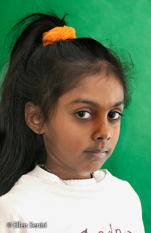MR / Schenectady, NY. Dr. Martin Luther King, Jr. Magnet School of Math, Science, Technology, and Invention / urban public school.Portrait of girl (7, Guyanese-American)..MR: Ram5.©Ellen B. Senisi