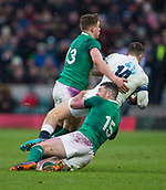 17th March 2018, Twickenham, London, England; NatWest Six Nations rugby, England versus Ireland; Jonny May of England is tackled by Garry Ringrose and Rob Kearney of Ireland